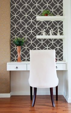Love the idea of papering or painting the back wall and adding shelves. Also love the drawers. Moroccan Wall Stencil Endless Circle by royaldesignstencils. Great shelving and a simple desk make this small office space or billpaying center very eyecatching yet clean and stylish. I can handle paying bills here!