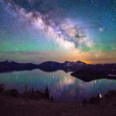 """Milky Way over Crater Lake National Park. A June (2015) visitor took this amazing photo. Of the experience, she says, """"I must've gotten over a dozen mosquito bites and hardly any sleep, but it's nights like this I'll never forget."""" (Photo courtesy of Tiffany Nguyen)"""