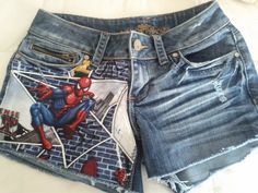 Custom. Denim shorts with Marvel Spider-Man fabric on one side. Also available in other fabrics. See pictures on Etsy, $29.99  I'M THINKING I COULD DIY THIS. (In a bigger size hahaha)