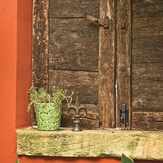 Old Wood Shutters  Give old wood new life by having it made into shutters and doors. They may look like authentic antiques, but the courtyard shutters are newly crafted with old wood Gary found at a lumberyard. The wood came from weathered timbers on which new wood was being stacked. Gary added new distressed hardware so they can be easily functional.