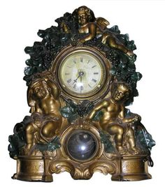 Antique Waterbury Cold-Painted Bronze Cupid Clock | This exceptional 19th century clock made by the Waterbury Clock Company features a cold-painted cast bronze frame depicting cherubs and green foliage.