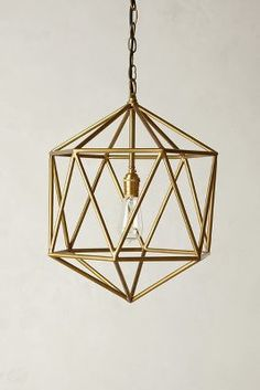 geometric light pendant in brass