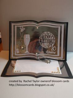 Made by Rachel Taylor - I have made a birthday easel card To make this easel card I have used  black silver white card some small pearl gems  Dies I have used are  Tattered lace Book Die (new die ) X cut champagne celebration die set (new die ) Tonic Studios Pop-Up Sentiments Happy Birthday Circle Die Set free Champagne glass die from simply cards and paper craft issue 145 out now (new die ) Britannia Dies - Small Number Set