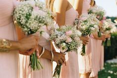 bridesmaids wear pink dresses and hold babies breath pink rose/carnation and maybe more green bouquets - if not baby's breath alone