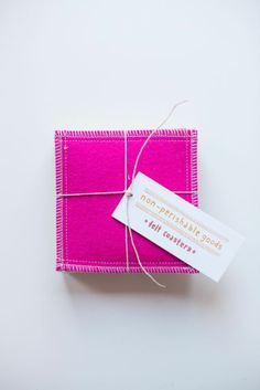 felt coaster set - warm colors - $36 - made from the scraps of pillows that are sold by the same company