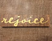 "Hand-painted wooden shelf-sitter/stocking stuffer.  Reads ""rejoice""."