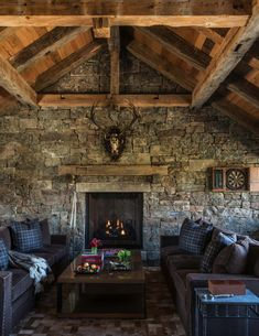 This ranch house features medieval-inspired craftsmanship by JLF Architects along with Big-D Signature, located in Jackson Hole, Wyoming. Sunken Living Room, Big Living Rooms, Jackson Hole, Game Of Thrones Bedroom, Medieval Home Decor, Rustic Sofa, Relaxation Room, Home Upgrades, Family Room Design