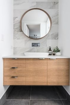 essastone is perfected for life, making it a great addition to any home. This stunning powder room features essastone in White Concrete