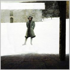 《 Outpost 》  The artist's wife Betsy Wyeth standing in front of a building on their Chadds Ford, Pennsylvania property.  -Andrew Wyeth