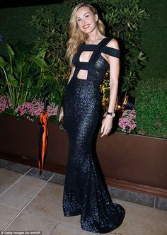 Shimmering into view: Petra Němcová pulled out all the stops for her evening out  at the a...