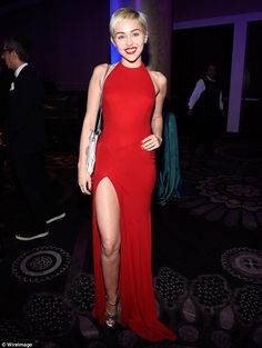 Demure: Miley Cyrus looked stunning in a sophisticated red dress for the pre-Grammy Gala o...