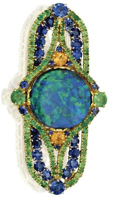 18 Karat gold, platinum, opal, sapphire, and garnet brooch, circa 1920. Set in the centre with a round black opal within an openwork plaque studded with round demantoid and spessartite garnets, accented by round sapphires, further decorated on the reverse with gold scrollwork, signed Tiffany & Co.