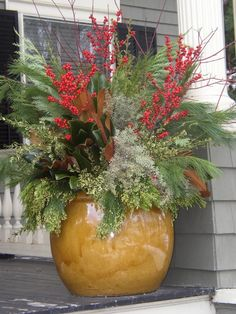 reminds me of an arrangement my mom would put together at the holidays.  Love the colors and textures.