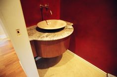 Cherry wood species. Contemporary bow vanity with Granite countertops