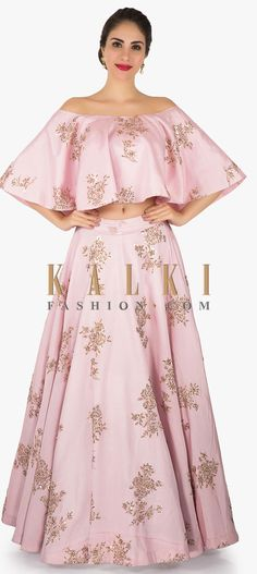 Buy Online from the link below. We ship worldwide (Free Shipping over US$100) Click Anywhere to Tag Pink dupion silk lehenga with off shoulder crop top adorn in zardosi only on Kalki The pink dupion silk lehenga is all set to bring the sass on. The contemporary styled lehenga is intricately designed in zardosi and moti embroidered work with sequin detailing all over. The cape blouse flaunts the very in trend off-shoulder pattern.