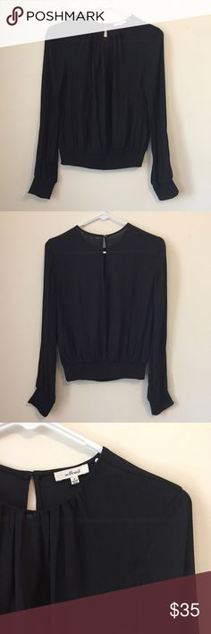Aritzia Wilfred Bezout Black Blouse 0 This feminine blouse is designed with pleats along the neckline, as well as a smocked hem and cuffs, which add shape to the silhouette. A pretty keyhole detail is featured at the back. 100% polyester. Size 0. Great condition - no holes or stains. Aritzia Tops Blouses