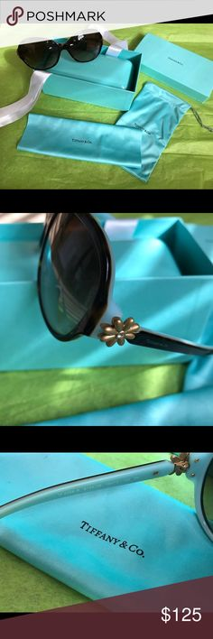 Tiffinay Daisy Sunglasses 😎 Like new . Used three weeks . Excellent condition. Includes all.  Case, clothe, Box w bow and soft pouch.  Size 58-15-130. Brown gradient lens , signature Tiffany Blue lined frame . Tortoise acetate frame . Gold daisy hardware on stems. 💞 Tiffany & Co. Accessories Sunglasses