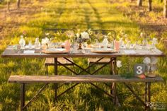 Vintage china, pastel coloured glasses/cutlery, vintage fan and turquoise blue vase glassware | Photo: Barnett Photography