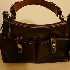 DOONEY AND BOURKE bag A beautiful dark brown genuine leather florentine vachetta Dooney and Bourke . It has an adjustable strap. The hang tag is in excellent condition and so is the bag. The hardware is not tarnished. Overall it's a great bag. Dooney & Bourke Bags Shoulder Bags