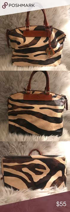 Dooney & Bourke Zebra Print Satchel This Dooney & Bourke Satchel is used and has a really good outside condition, but the inside has a lot of stains.  Still a great bag!  Please see my other listing for MATCHING wallet! Dooney & Bourke Bags Satchels