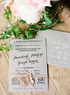 elegant grey wedding invites, photo by Laura Murray http://ruffledblog.com/devils-thumb-ranch-wedding #invitations #weddinginvitations