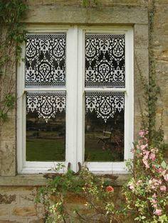 Lace stencil design on windows - Decoist