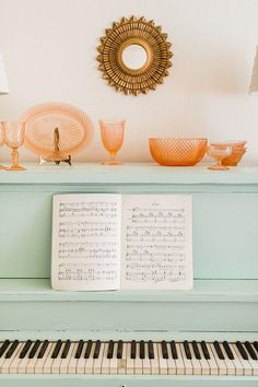 Update heirlooms with paint like this gorgeous baby blue painted piano! Such a great DIY project to try. Could also try updating other pieces of furniture, cabinets, side tables, trunks, or tables with paint for a similar statement-making effect. Love the pretty peach glassware on top for contrast!