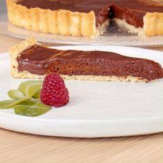 Ein Traum aus Schokolade – und ein echter Klassiker noch dazu. So gelingt dir die perfekte Schokotarte!