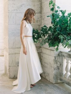 The Soho top is loved by the modern bride. Made from our most pristine bridal satin, this sleeveless top with a jewel neckline is breathtakingly elegant in its quiet simplicity. Pair this top with one
