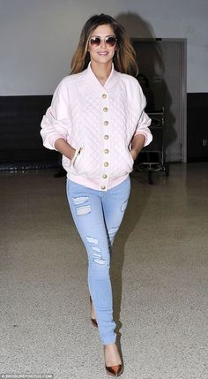 Jetsetter: Cheryl Cole wows in a quilted leather bomber jacket as she arrives in Los Angeles