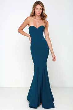 "Amp up your ""curve"" appeal at that upcoming gala with the Sorella Navy Blue Strapless Maxi Dress! A strapless sweetheart bodice has a stunning fitted shape thanks to a hidden V-bar at front, boning and elastic at back, and princess seams. The woven material makes its way down into the maxi skirt finished with flaring godets, and hidden bottom band for added structure. Hidden back zipper with clasp."