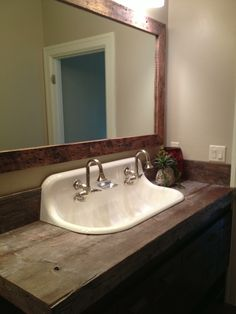 Bathroom sink...for two! I love this but it doesn't match my decor.