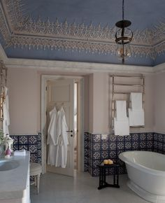 jacques grange designed the ornate ceiling and tile work in the bathroom of suite no. 4- beeline black lacquered porters drink table next to bath tub