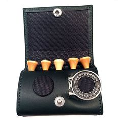 This Golf Tee Wallet and Divot Repairer and Ball Marker is Hand Made in England using our Luxury Carbon Fibre Black Leather.