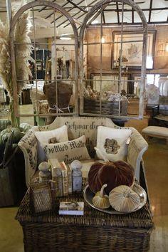 gorgeous antique textile pillows and furniture... love the plush pumpkins, too.