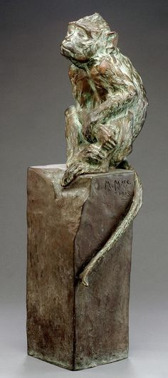 A bronze sculpture of a seated monkey by Maurice Roger Marx