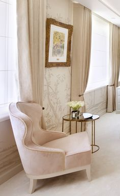 Heavy curtains and delicate floral chinoiserie wallcovering by Fromental add to the luxurious design of this master bedroom by 1508 London.