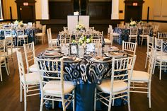 White Chiavari Chairs and Navy Blue Linens | Rentals by A Chair Affair and Over the Top Rental Linens Lakeland Wedding Venue Junior League Sorosis Building