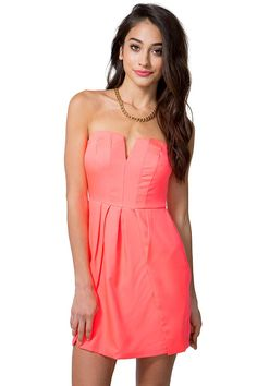 A short strapless dress featuring a structured sweetheart bust with a hidden v-bar. Lightly pleated skirt. Concealed zip and hook-eye closure in the back. Finished hem. Fitted. Fully lined. BOUTIQUE FIVE.