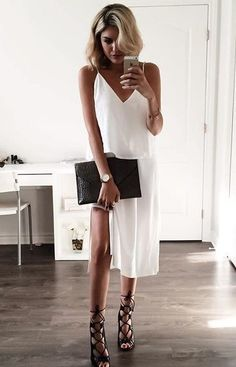 A white slip dress and an oversized back clutch are perfect for a minimalist evening look