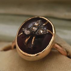 A really unusual X-large garnet cabochon with a diamond-studded fly perched on top. Weird and totally wearable, c. 1840. See it at our Manhattan shop or visit it online.