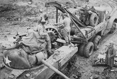 In field repairs on a Sherman engine....