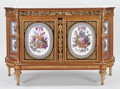 Cabinet   Royal Collection Trust By Martin  Carlin (1730-85) Oak cabinet veneered with tuliwood,purplewood,mahogany and boxwood,fitted with  brocatello marble,elaborately chased gilt bronze mounts and inset with ten soft-paste porcelaine plaques.