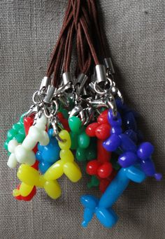 Balloon animals in all colors and shapes. Handy / Cell Phone charm or zipper pull. $6.00, via Etsy.