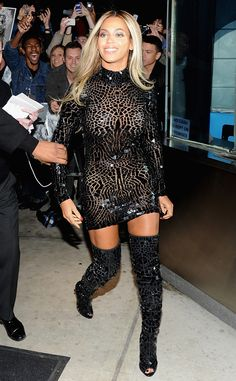 Bey wore a jagged mosaic-patterned Tom Ford mini with thigh high boots at her self-titled album's release party in NYC.