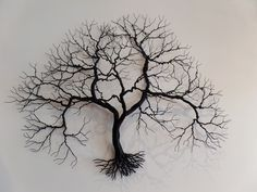 Black Wall Tree - We are proud to be the exclusive dealer in CT of these beautiful hand made metal sculptures reminiscent of the windblown trees on our eastern shoreline. The artist creates table sculptures as well as wall hung single trees.
