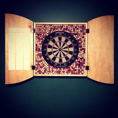We put wine corks behind a dart board to prevent darts from bouncing off the backboard! Turned out awesome!
