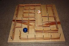 Start with a board, mark off a grid and hammer a nail in each intersection.  Use rubber bands to create a maze for the bouncy balls.  Hours of fun for kids :)