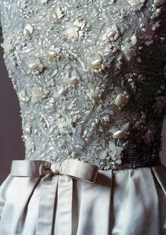 Detail of exquisite mother-of-pearl embroidery on Dior's white satin dress, 1956, photo by Sacha Van Dorssen, 1987