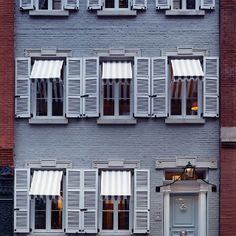 Miles Redd New York townhouse with blue and white stripped awnings reminiscent of the South of France.  Gill Schafer.